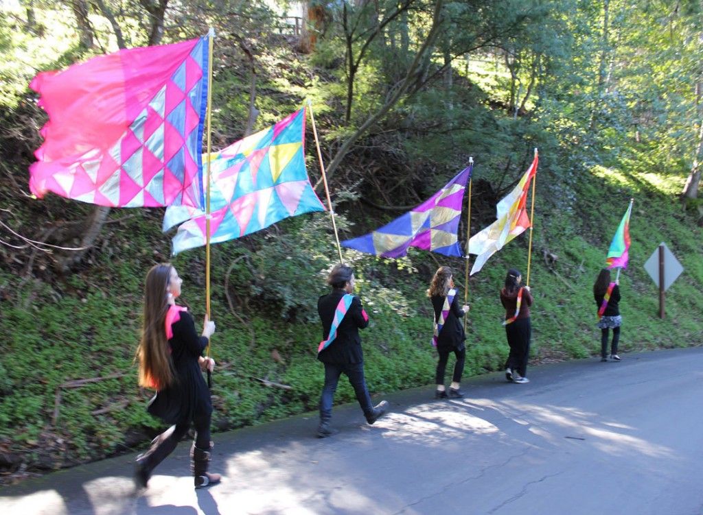 Christine Wong Yap, Irrational Exuberance Flags, 2012–13, five flags and five sashes; flagpoles, bases; participation; flags: 48 x 48 up to 48 x 80 inches each, poles: 8 to 30 feet each. Supported by Lucas Artists Program at the Montalvo Arts Center.