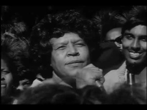 "Bayview community activst Eloise Westbrook speaks at a rally in support of the SF State student strike, December 1968. Still from ""On Strke! (At SF State)"" by Saul Rouda and David Dobkin with SF Newsreel"